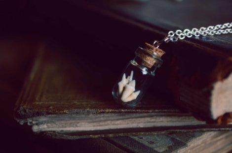 Bottled Skunk Teeth Necklace by LadyLocks Creations